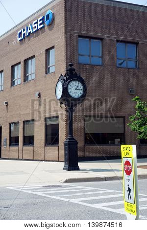 LA GRANGE, ILLINOIS / UNITED STATES - MAY 21, 2016: The municipal clock stands in front of the Chase Bank in the central business district in downtown La Grange, Illinois.