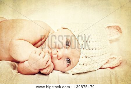 portrait of female newborn with bunny woolen hat