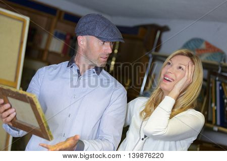 woman and man buying stuff on flea market