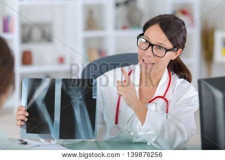 lady doctor in uniformslooking at x-ray