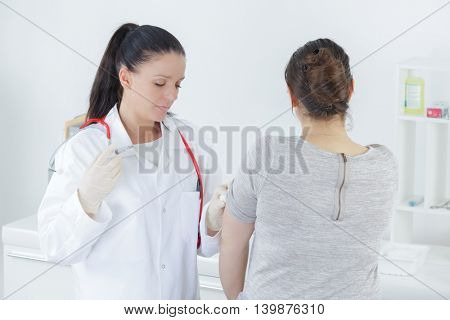 doctor examining her patients stomach in medical office
