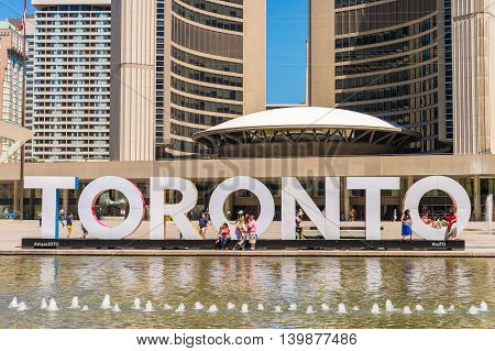Toronto, Canada - 4 July 2016: 3D Toronto sign and Nathan Phillips Square in Toronto Canada