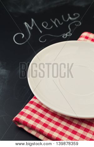 Empty plate on chalkboard with word menu