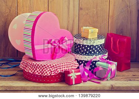 Retro style gift boxes over wooden background