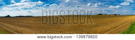 Panorama Of Harvested Wheat Fields And Dramatic Blue Sky In July, Belgium