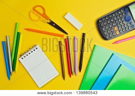 School suplies on yellow background. Back to school concept