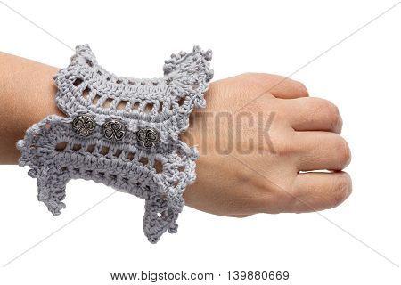 Knitted handmade blue bracelet isolated on white background