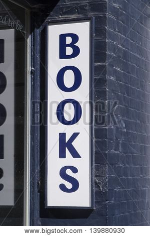A BOOKS sign at a traditional bookstore in a UK town.