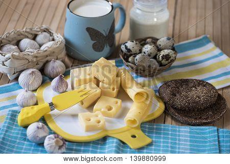Cheese, garlic, milk and sour cream, eggs, bread