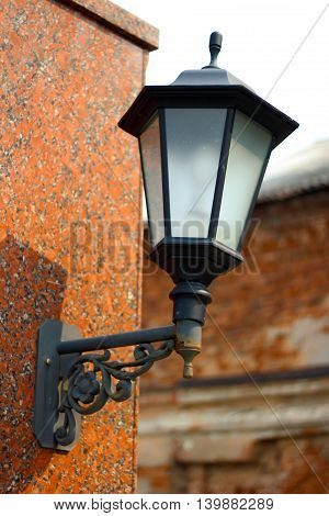 retro lantern on a stone wall decor outside