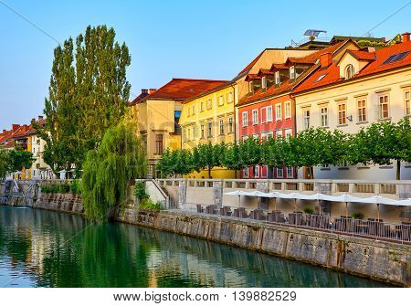 The old houses on the river bank early morning. Ljubljana Slovenia