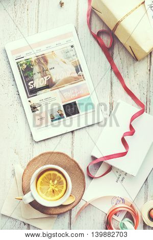 Tablet Online Shopping Tea Present Concept