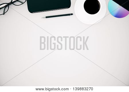Top view of white office desktop with coffee cup cd pen smartphone and glasses. Mock up 3D Rendering