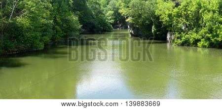 green lake or river pond landscape with trees panoramic