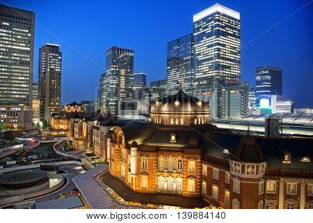 The exterior of the famous Tokyo Train Station at night, which has stood in the Marunouchi district for over 100 years. All identifiable logos removed.