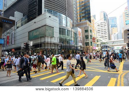 HONG KONG - NOV 9: Hong Kong Des Voeux Road Central at the center of Financial District on Nov 9, 2015 in Hong Kong. Des Voeux Road is a major road on the north shore of Hong Kong Island.