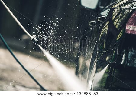 Detailed Car Washing. Cleaning Alloy Wheels by High Pressured Water