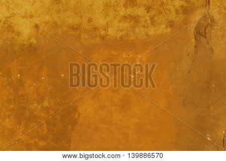 Dirty Orange Browny Wall Background. Damaged Ugly Concrete Wall Texture.