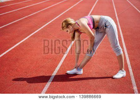 Woman runner warm up her body outdoor