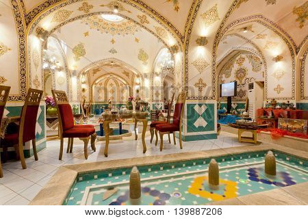 ISFAHAN, IRAN - OCT 15, 2014: Interior of retro restaurant with traditional painted walls and water fountains on October 15, 2014. Third largest city in Iran Isfahan is the best example of Islamic culture