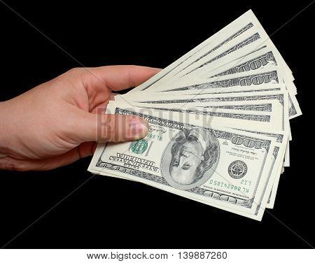 Money in hand dollars on black background