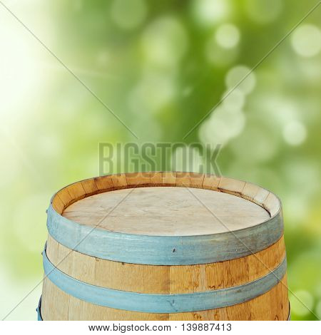 Wooden barrel over garden bokeh background. Ready for product display montage