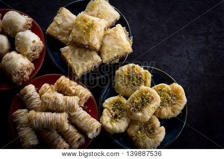 Variety of Baklava on Dark Background From Above with Copy Space