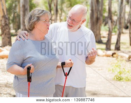 Happy Healthy Senior Couple Exercising Outside Together.