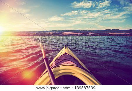 Scenic Kayak Summer Tour on the Lake. Kayaking During Lake Sunset. Outdoor Sports.