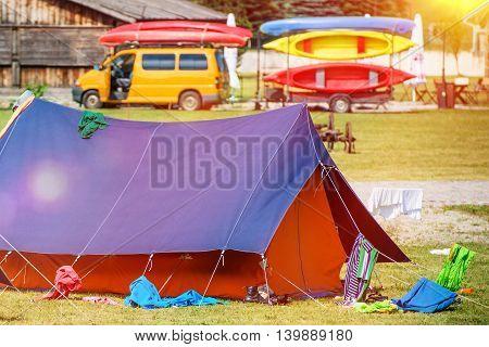 Vacation Kayak Camp. Summer Camping with Kayaking Concept Photo.