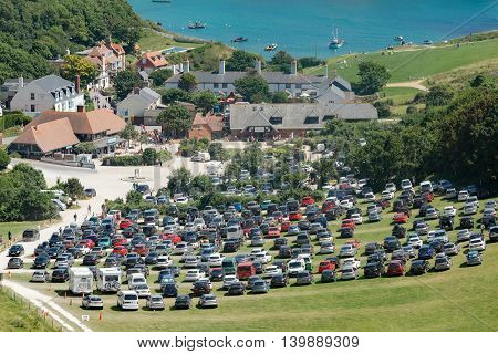 Lulworth/UK. 20th July 2016. On a warm July day, the car park for Lulworth Cove is starting to get busy.