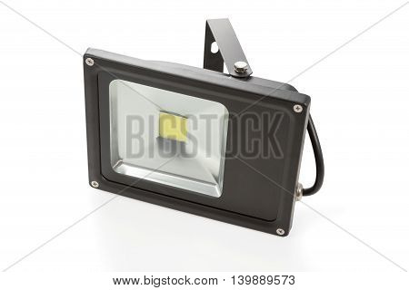 Economical LED spotlight black with cable isolated on white background