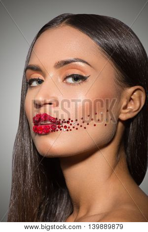 beauty woman face with creative make up red lips roses