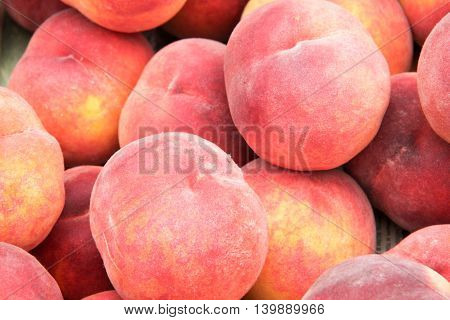 peaches on the counter market as a background.