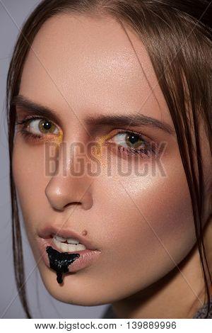 beauty creative makeup with black blob lips