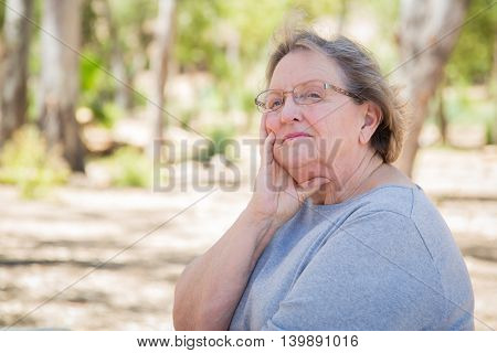 Upset Senior Woman Sitting Alone Outside.
