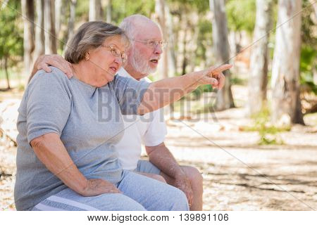 Senior Couple Enjoying The Outdoors At Park.