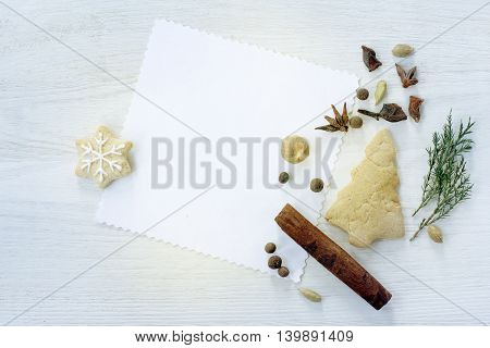 flat lay festive background with Christmas tree and gingerbread star and various spices top view / fragrant greeting Christmas fantasy