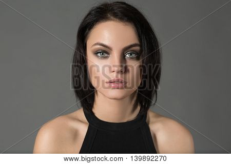 Portrait of fashionable short hair cute woman looking at camera