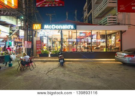 PATTAYA, THAILAND - CIRCA FEBRUARY, 2016: McDonald's on Walking Street in Pattaya at night time. is a red-light district in the city of Pattaya, Thailand