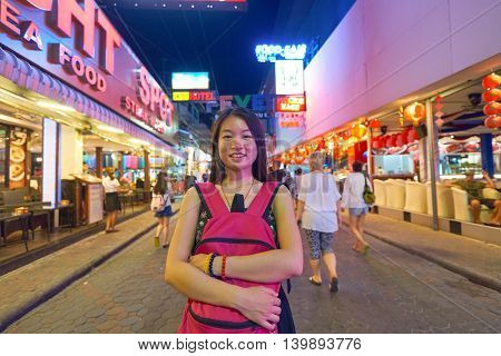 PATTAYA, THAILAND - CIRCA FEBRUARY, 2016: outdoor portrait of asian woman on Walking Street in Pattaya at night time. is a red-light district in the city of Pattaya, Thailand