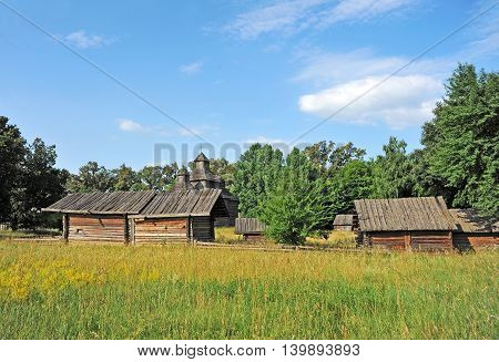 Ancient Wooden Barn And Church