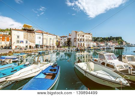 Piran, Slovenia - May 7, 2016: View on marina with fishing boats in Piran old town. Piran is one of Slovenia's major tourist attractions.