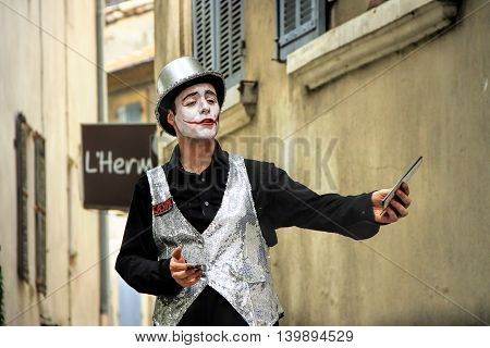 AVIGNON, FRANCE - JULY 19 2014: Actor in historical costume advertising his performanceduring famous theatre festival from July 4 to 27 2014 in Avignon south of France.
