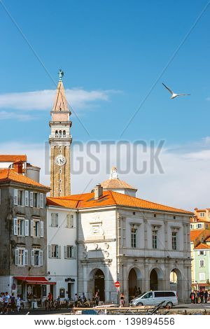 Piran, Slovenia - May 7, 2016: Piran old town center with church tower and old buildings. Piran is one of Slovenia's major tourist attractions.