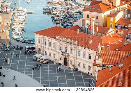 Piran, Slovenia - May 7, 2016: Top view on Tartini square with town hall building in Piran town. Piran is one of Slovenia's major tourist attractions.