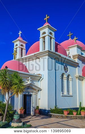 Greek church of the Cathedral of twelve apostles. Pink dome crowned with snow-white church building