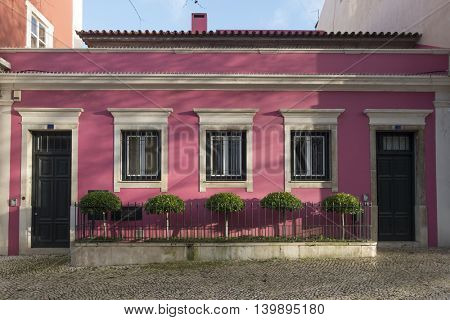 Two pink houses in Lisbon, Portugal, photographed as the sun was about to set.
