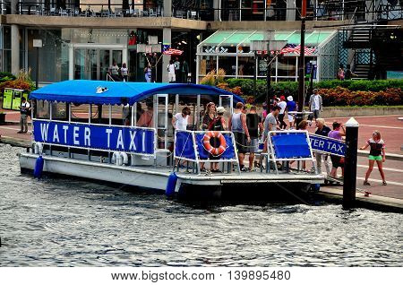 Baltimore Maryland - July 22 2013: Passengers disembark from a water taxi boat at the Inner Harbor stop