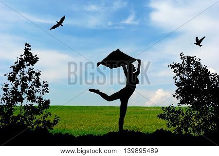 Young Girl Silhouette With Shawl Dancing On Green Meadow And Blue Cloudy Sky Background